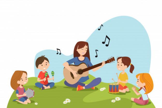 dzieci-i-nauczyciel-siedzi-na-trawie-i-gra_74855-5764.jpeg